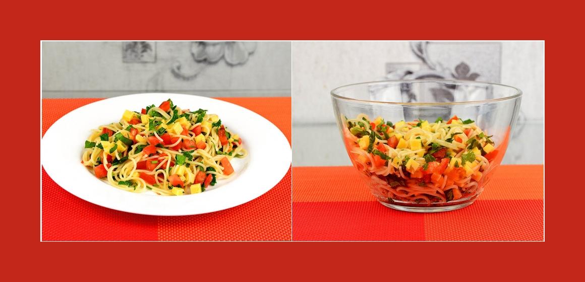 Nudelsalat mit Käse Tomaten Petersilien