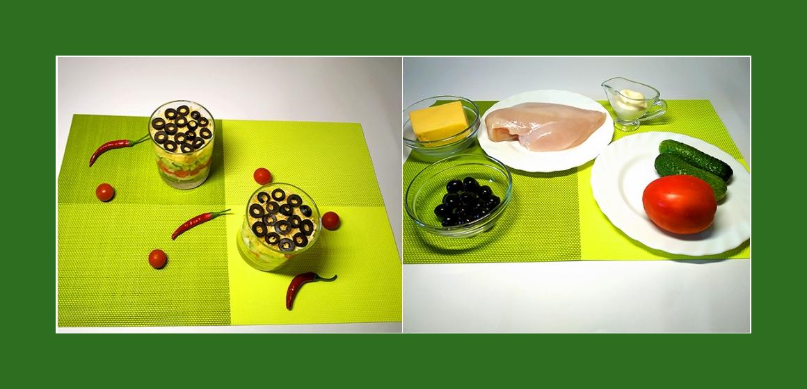Pikanter Hänchensalat mit Tomaten, Gurken, Oliven und Käse