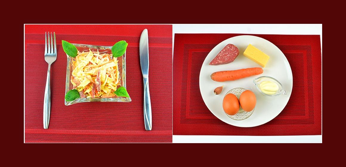 Nahrhafter Salat mit Möhren, Omelett, Wurst und Käse