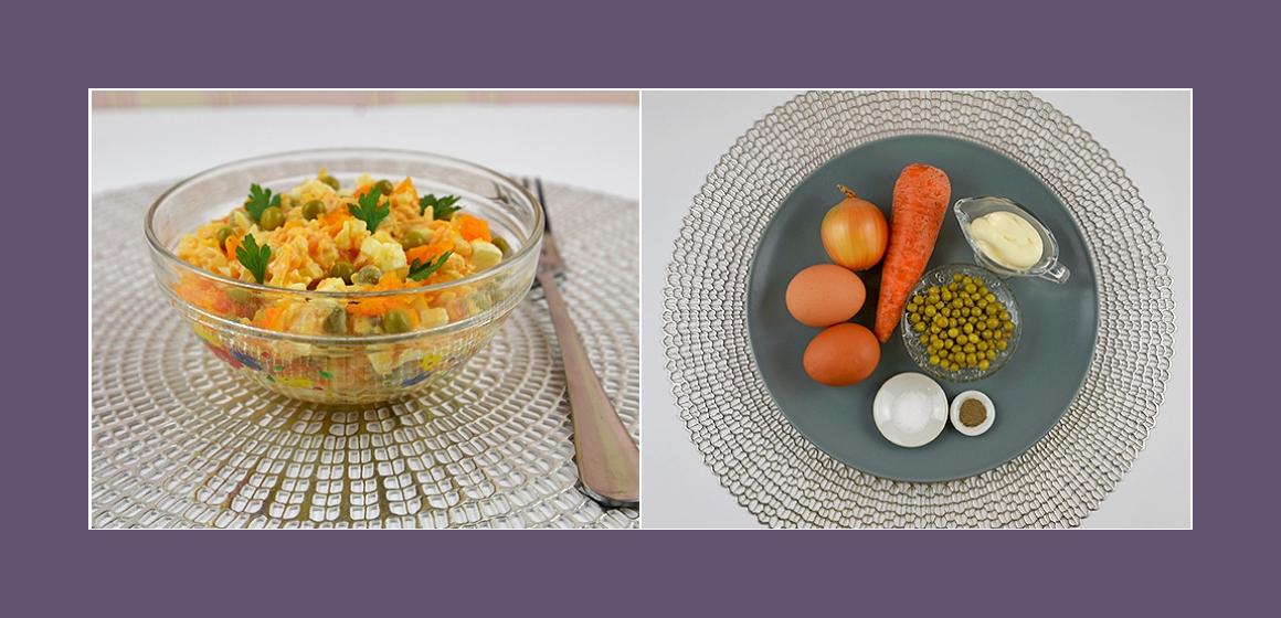 Nahrhafter Salat mit Möhren Eiern Zwiebeln und Erbsen