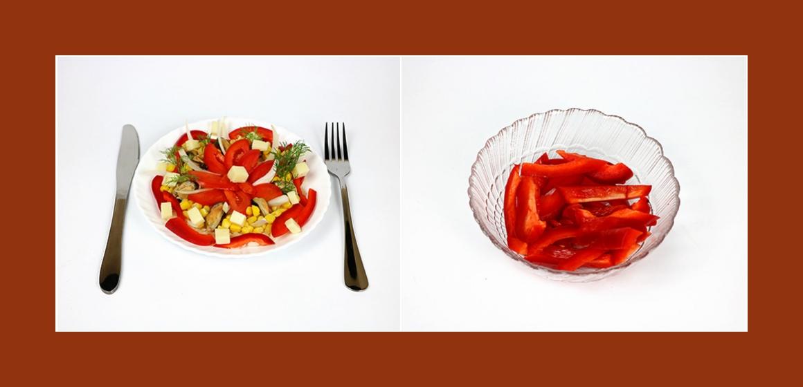 Nahrhafter Salat mit Reis, Muscheln, Käse, Paprika und Mais