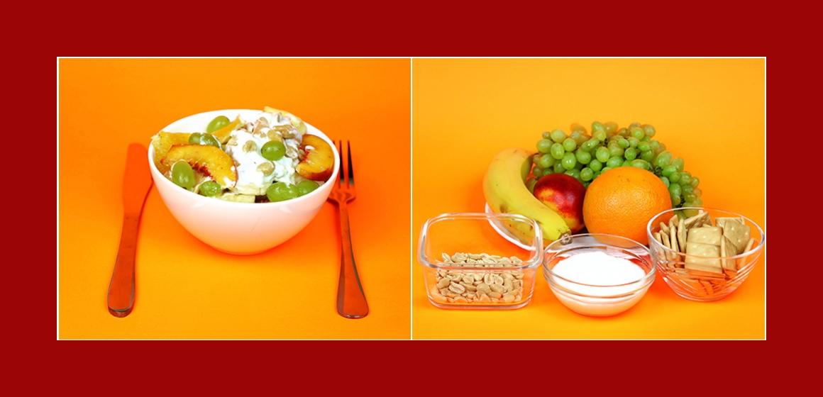Leckerer Fruchtsalat mit Crackern Orangen Bananen Trauben Pfirsichen und Nüssen