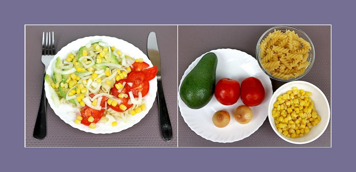 Nahrhafter Gemüsesalat mit Nudeln, Avocado, Mais, Zwiebeln und Tomaten