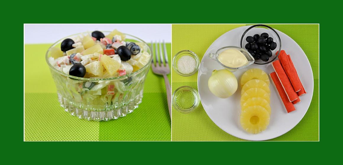 Nahrhafter Salat mit Ananas Krabbenstangen Oliven und Zwiebeln