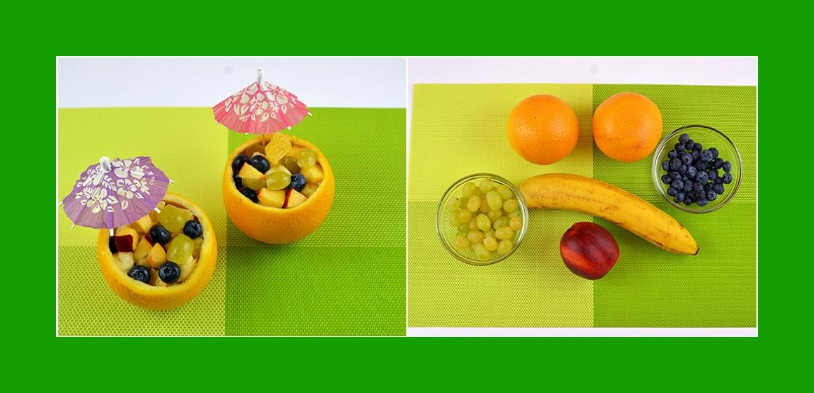Leckerer Obstsalat mit Bananen Orange Trauben Pfirsich und Blaubeeren