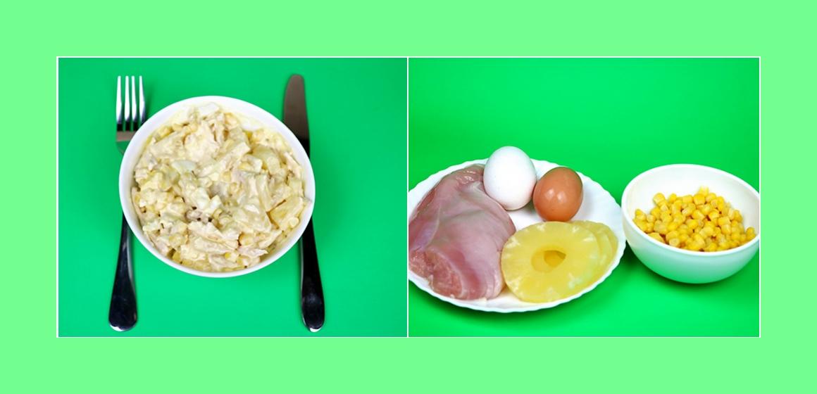 Leckerer Salat mit Hühnerbrust, Eiern, Mais und Ananas