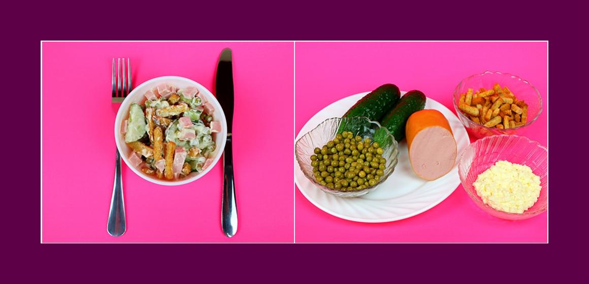 Nahrhafter Salat mit Wurst Gurken Erbsen und Croutons
