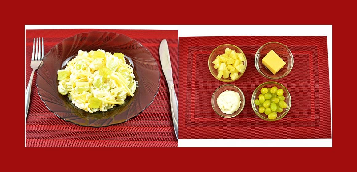 Köstlicher Obstsalat mit Käse, Weintrauben, Ananas und Mayonnaise
